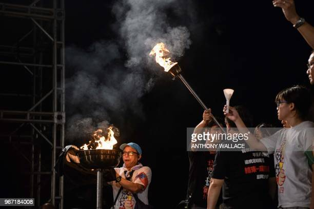 A cauldron is lit on stage during a vigil in Hong Kong on June 4 to mark the 29th anniversary of the 1989 Tiananmen crackdown in Beijing Crowds...