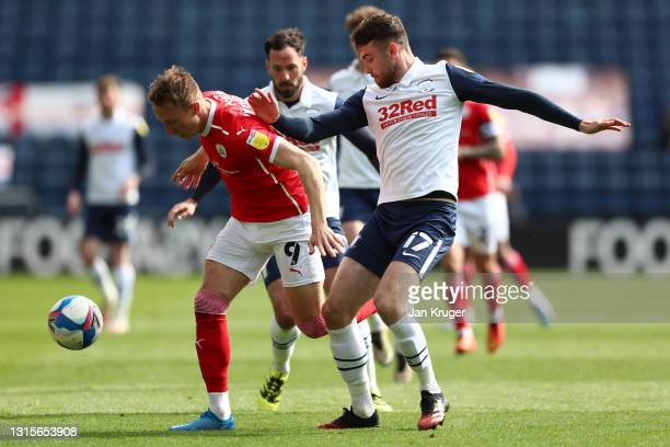 Cauley Woodrow of Barnsley battles for possession with Benjamin Whiteman of Preston North End during the Sky Bet Championship match between Preston...
