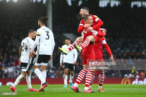 Cauley Woodrow of Barnsley celebrates with teammates after scoring his team's first goal during the Sky Bet Championship match between Fulham and...