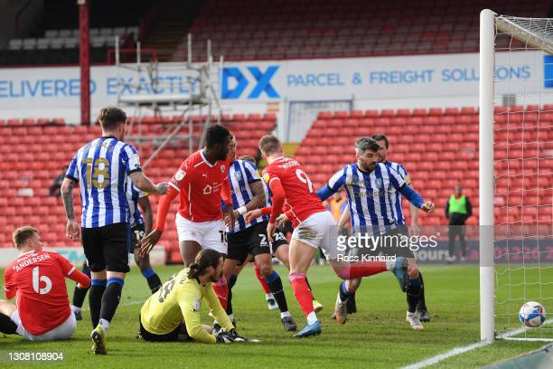 Cauley Woodrow of Barnsley FC puts the ball in the net but the goal is disallowed during the Sky Bet Championship match between Barnsley and...