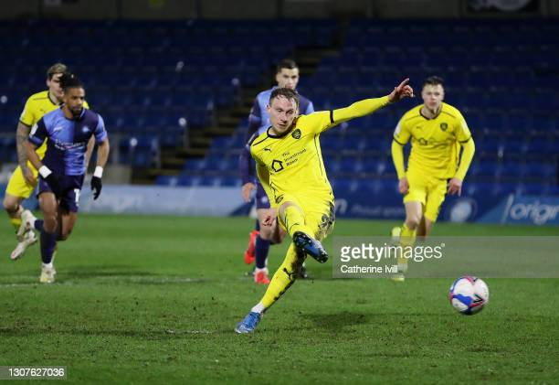 Cauley Woodrow of Barnsley FC scores their team's first goal from the penalty spot during the Sky Bet Championship match between Wycombe Wanderers...