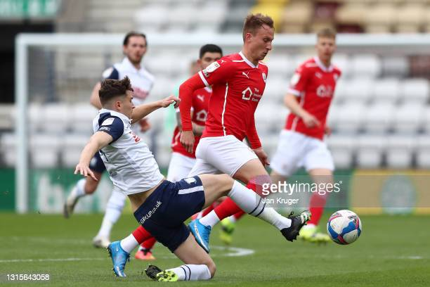Cauley Woodrow of Barnsley is challenged by Jordan Storey of Preston North End during the Sky Bet Championship match between Preston North End and...