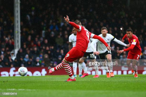 Cauley Woodrow of Barnsley scores his sides first goal from a penalty during the Sky Bet Championship match between Fulham and Barnsley at Craven...