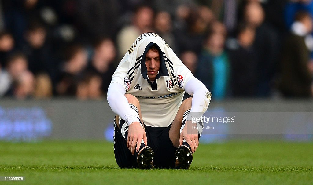 Cauley Woodrow of Fulham sits dejected after the final whistle during the Sky Bet Championship match between Fulham and Bristol City at Craven Cottage on March 12, 2016 in London, United Kingdom.