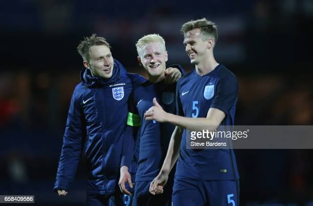 Cauley Woodrow Will Hughes and Rob Holding of England smile after victory in the U21 international friendly match between Denmark and England at...
