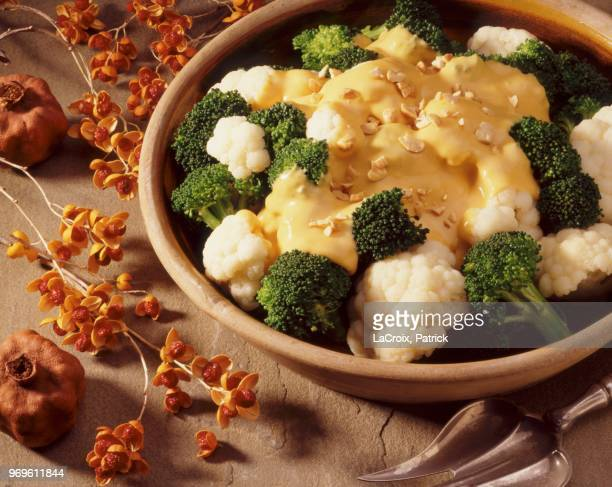 cauliflower and broccoli with cheese sauce - cheese sauce stock photos and pictures