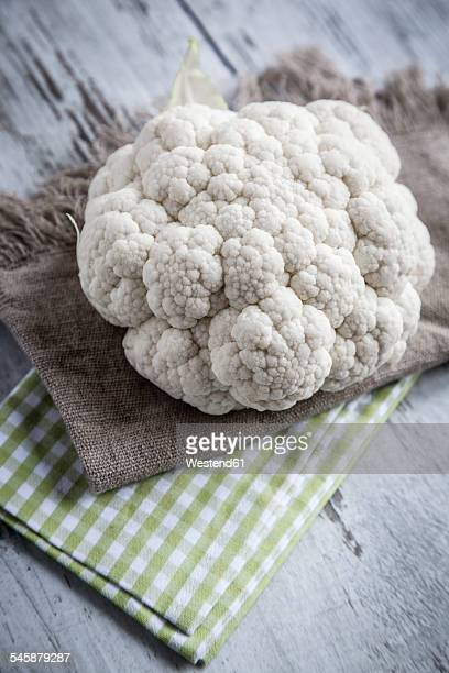 Cauliflower on cloth and wood