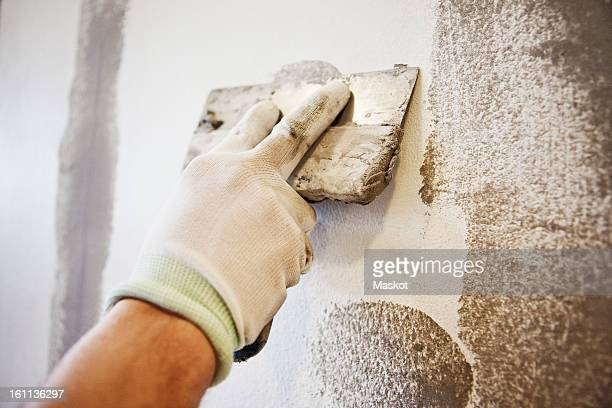 caulking blade being used to spread filler - wall building feature stock pictures, royalty-free photos & images