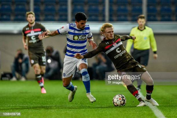 Cauly of MSV Duisburg and Mats Moeller Daehil of St Pauli battle for the ball during the Second Bundesliga match between MSV Duisburg and FC St Pauli...