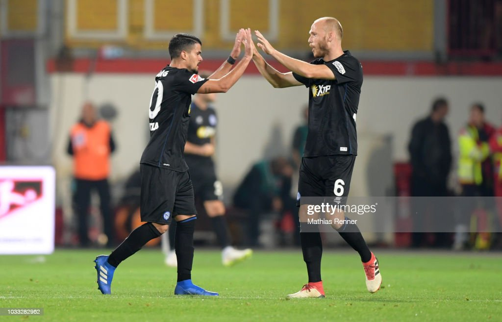 Cauly Oliveira Souza and Gerrit Nauber of MSV Duisburg celebrate after scoring the 1:1 during the game between Union Berlin and the MSV Duisburg at the Stadion an der Alten Foersterei on september 14, 2018 in Berlin, Germany.