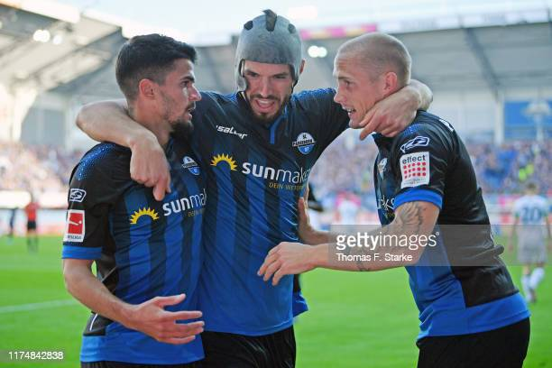 Cauly Oliveira Souza Klaus Gjasula and Sven Michel of Paderborn celebrate their teams first goal during the Bundesliga match between SC Paderborn 07...