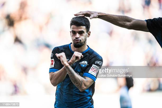 Cauly Oliveira Souza of Paderborn celebrates his team's first goal during the Bundesliga match between SC Paderborn 07 and FC Schalke 04 at Benteler...