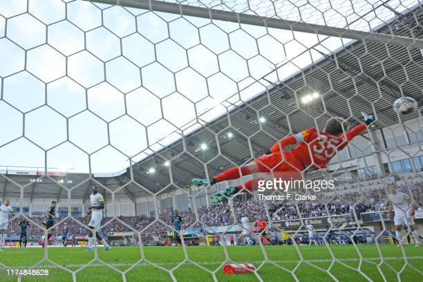 Cauly Oliveira Souza of Paderborn scores his teams first goal against goalkeeper Alexander Nuebel of Schalke during the Bundesliga match between SC...