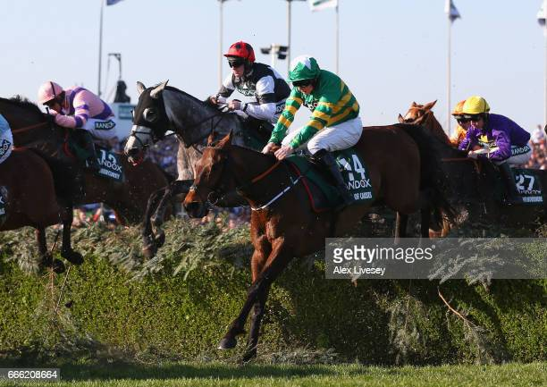 Cause of causes ridden Jamie Codd clears the Water Jump on their way to second place in the 2017 Randox Health Grand National at Aintree Racecourse...