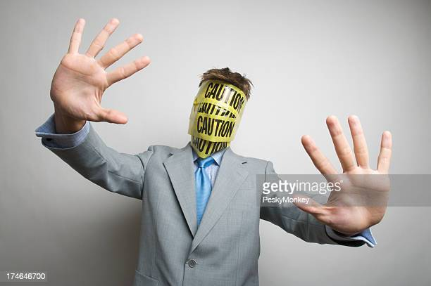 Caution Businessman Holds Out Hands