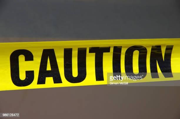 Caution cordon tape around building maintenance work