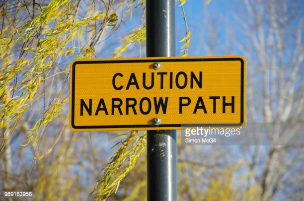 'caution: narrow path' sign - warning sign stock pictures, royalty-free photos & images