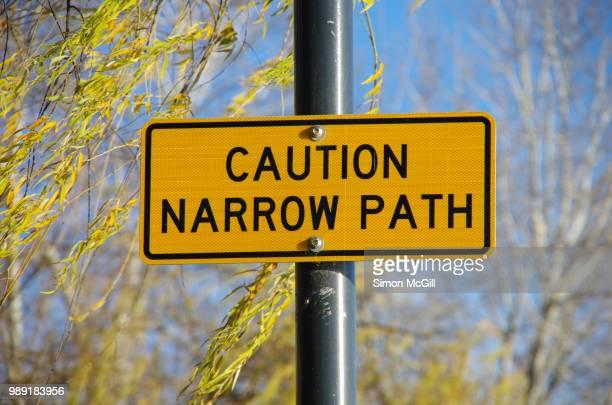 'Caution: Narrow path' sign