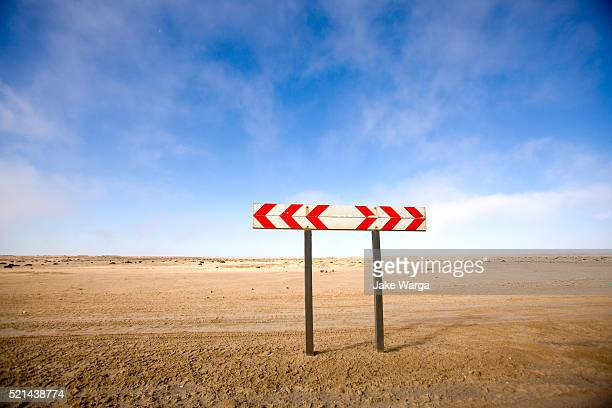 caution roadsign, namibia - jake warga stock photos and pictures
