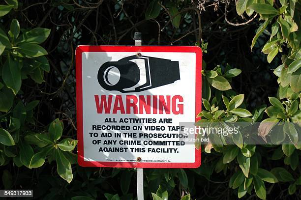 Caution sign against paparazzi in Malibu Warning o video surveillance to protect the privacy of the stars