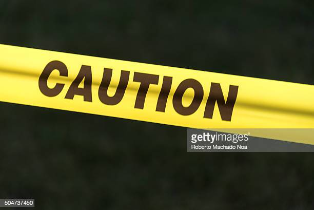 Caution sign Caution sign tape against black background concept of warning and danger