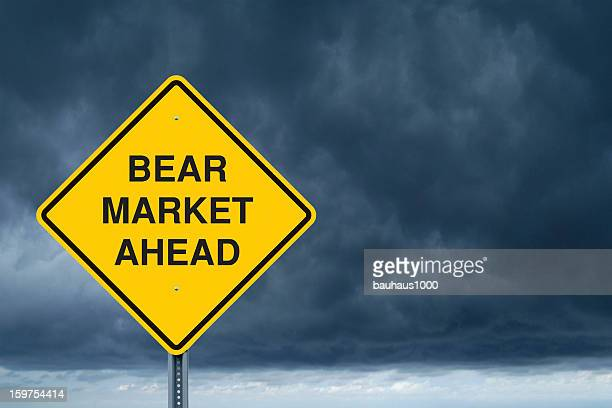 caution sign in front of storm clouds - bear market stock pictures, royalty-free photos & images
