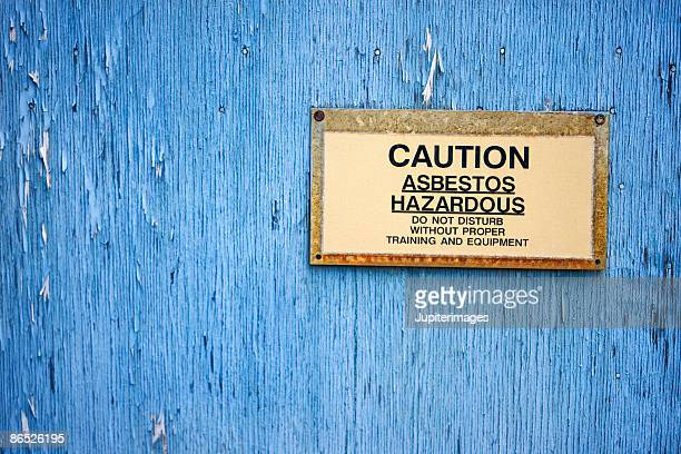Caution sign warning of asbestos hazard