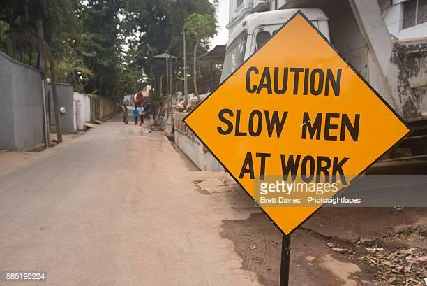 Caution Slow Men at Work sign