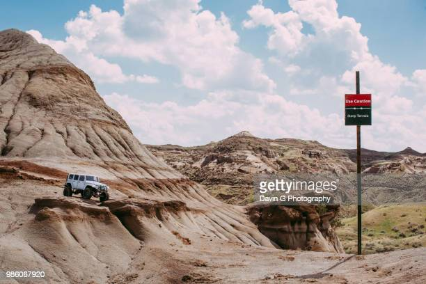 caution steep terrain - jeep stock pictures, royalty-free photos & images