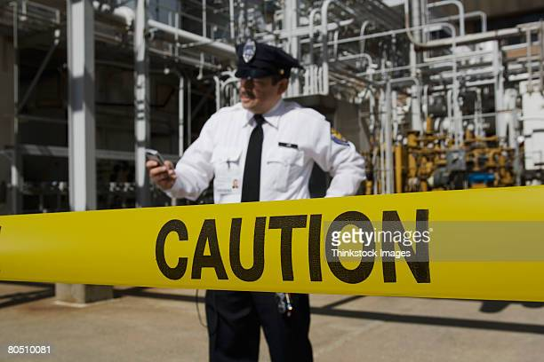 Caution tape and security guard