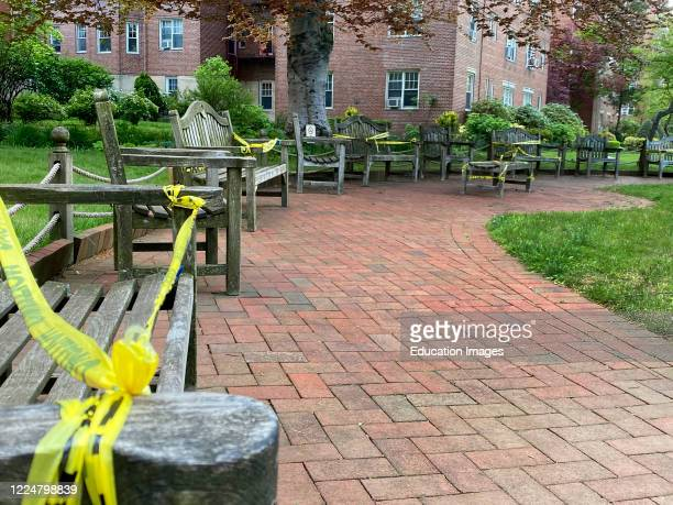 Caution Tape blocking off benches to encourage social distancing in park, Rego Park, Queens, NY.