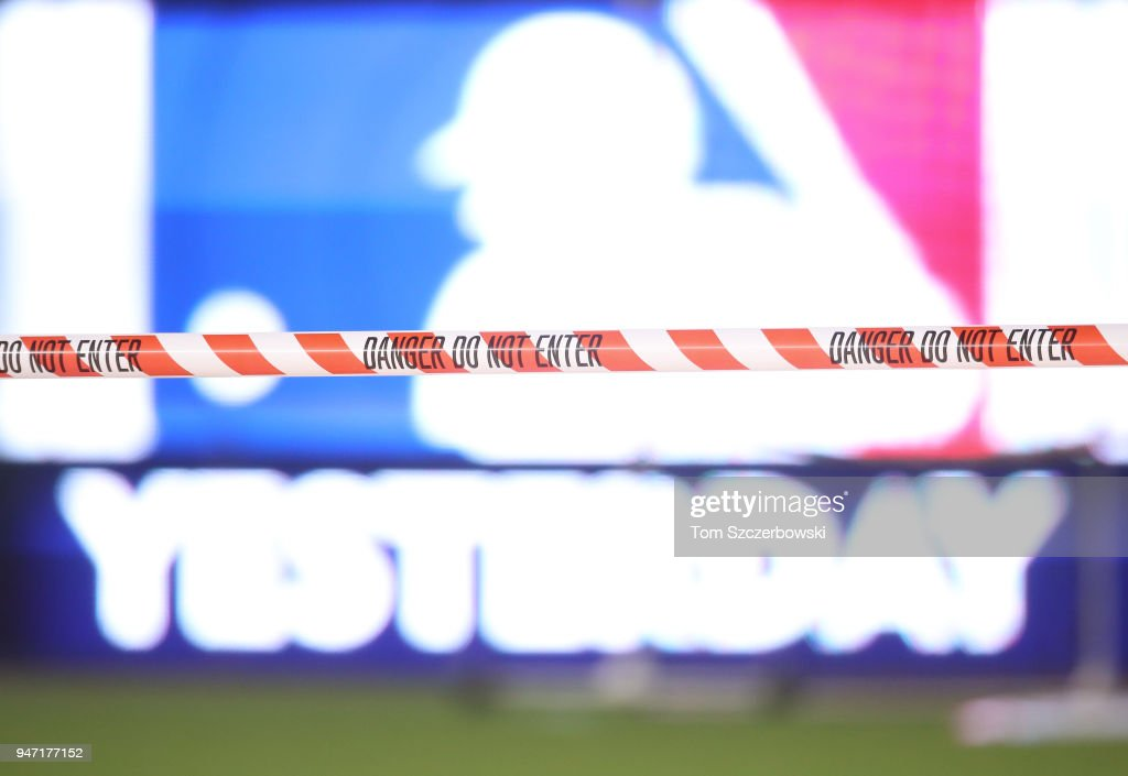 Caution tape blocks entry to the Rogers Center after after falling ice from the CN Tower caused a hole in the roof, postponing tonigh's MLB game between the Toronto Blue Jays and Kansas City Royals at Rogers Centre on April 16, 2018 in Toronto, Canada.