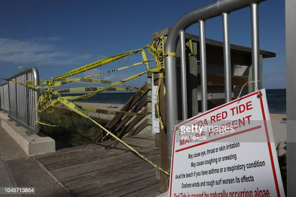 Caution tape closes off an entrance to the beach as Palm Beach County officials announced that all county beaches are closed due to red tide...