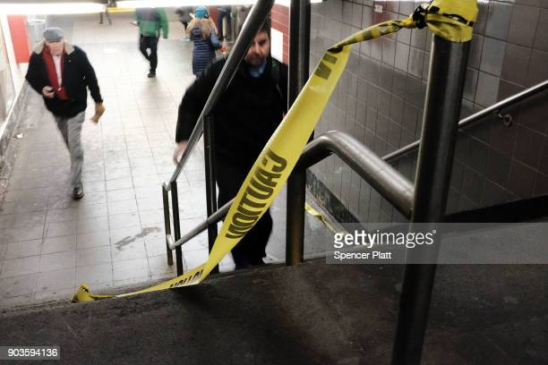 Caution tape hangs from a railing at a subway station on January 10 2018 in New York City The New York City subway system which opened in 1904 and is...