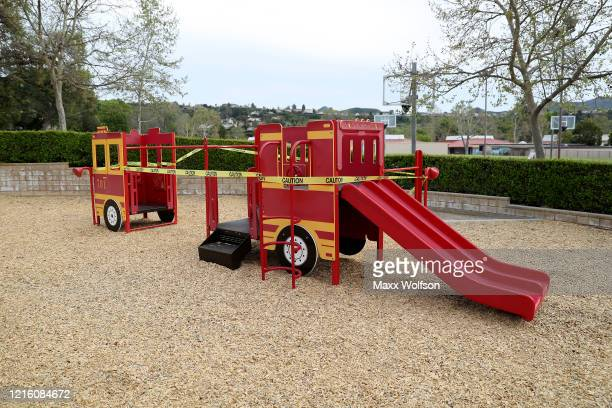 Caution tape is placed over the equipment at Berniece Bennett Park to prevent people from gathering on March 31 2020 in Westlake Village California...