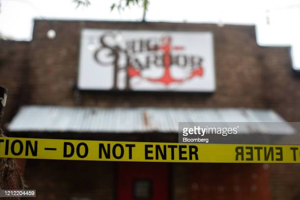 Caution tape is seen in front of a music venue in the Plaza Midwood neighborhood of Charlotte North Carolina US on Friday May 8 2020 Governor Roy...