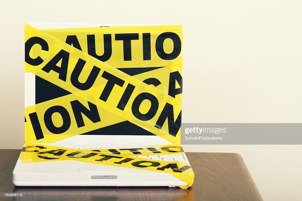Caution Tape Laptop : Stock Photo
