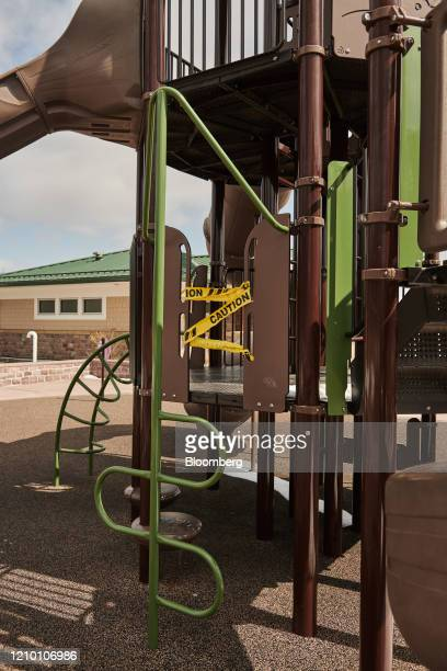 Caution tape surrounds a playground at Falls Park in Sioux Falls South Dakota US on Wednesday April 15 2020 South Dakota Governor Kristi Noem has...
