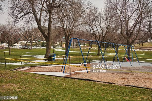 Caution tape surrounds a playground at Sherman Park in Sioux Falls South Dakota US on Wednesday April 15 2020 South Dakota Governor Kristi Noem has...