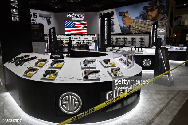 Caution tape surrounds the Sig Sauer Inc display ahead of the National Rifle Association annual meeting at the Indiana Convention Center in...