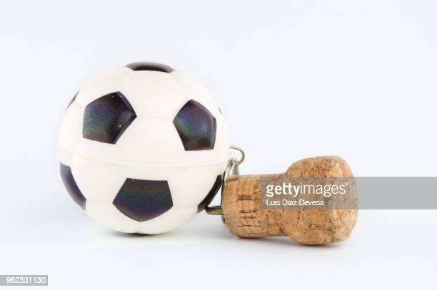 cava cork keyring holding ball - cork stopper stock photos and pictures