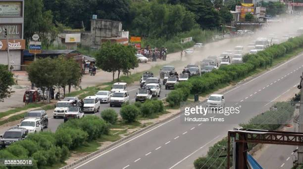 Cavalcade of Sant Gurmeet Ram Rahim Singh Insan crossing from Zirakpur flyover to CBI Court Panchkula on August 25 2017 in Chandigarh India The...