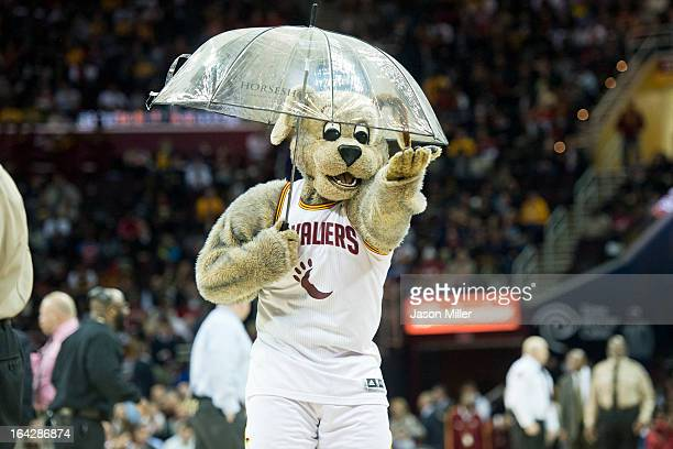Cavaliers mascot Moondog makes light of a technical malfunction with the scoreboard that resulted in fluid dripping onto the court prior to the start...