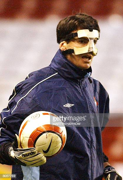 Cavallero one of RC Celta de Vigo goalkeepers wears a face guard during a practice session in at Highbury North London 09 March 2004 Celta play...