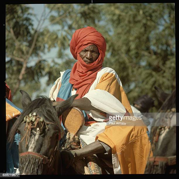 A cavalry guard of the Emir of Kano sits on horseback Kano Nigeria