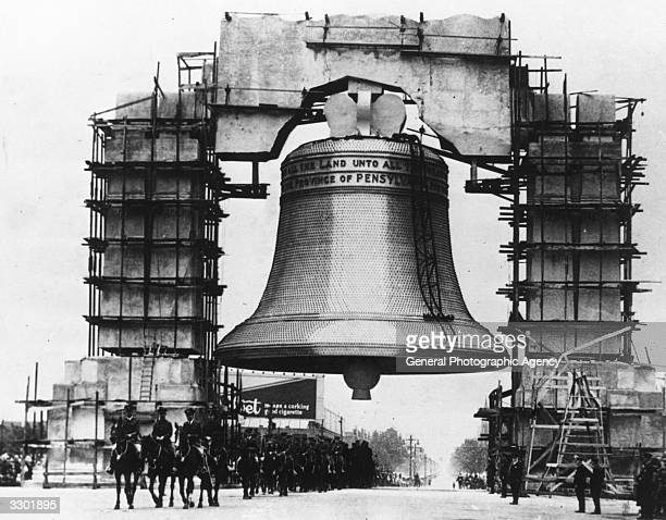 A cavalry regiment leading the inaugural parade beneath a huge reproduction of the Liberty Bell built for the opening of the Great Exposition in...