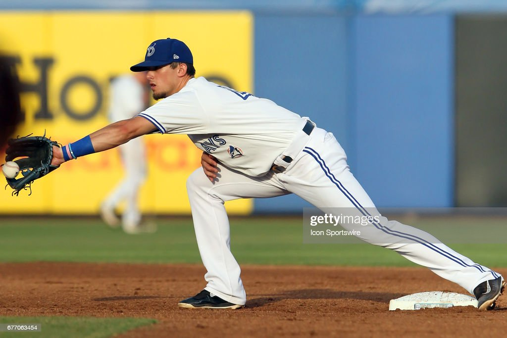 Cavan Biggio (4) of the Blue Jays takes the throw down to second base during the Florida State League game between the Tampa Yankees and the Dunedin Blue Jays on May 01, 2017, at Florida Auto Exchange Stadium in Dunedin, FL.