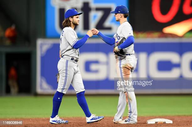Cavan Biggio of the Toronto Blue Jays celebrates with Bo Bichette after a 8-5 victory against the Baltimore Orioles at Oriole Park at Camden Yards on...