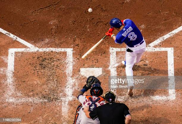 Cavan Biggio of the Toronto Blue Jays hits a home run against the Houston Astros in the fourth inning during their MLB game at the Rogers Centre on...