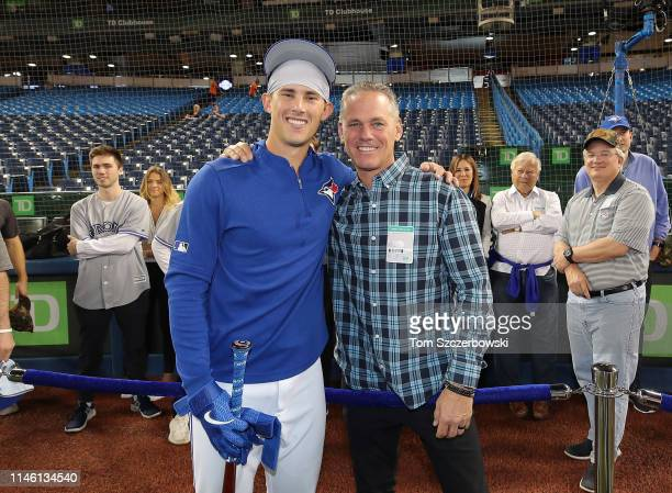 Cavan Biggio of the Toronto Blue Jays poses with his father and Hall of Fame member Craig Biggio before making his MLB debut against the San Diego...